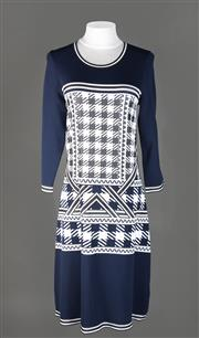 Sale 8493A - Lot 1 - An Escada Sport long sleeve dress in deep blue, size S, with original price tag AUD $958