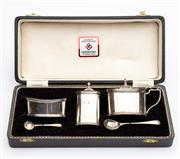 Sale 8590A - Lot 81 - A boxed sterling silver five piece cruet set, with two associated spoons, Birmingham, JBC & Sons 1973, tallest H 8cm, boxed