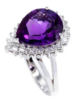 Sale 8937 - Lot 474 - AN 18CT WHITE GOLD AMETHYST AND DIAMOND RING; pear cut amethyst of approx. 3.7ct within a border of 24 round brilliant cut diamonds..