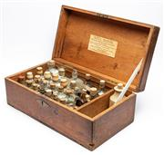 Sale 9054E - Lot 60 - A Henry Metzler Chemists travelling trunk in Pine containing an assortment of tinctures in glass and ceramic jars. width 50cm