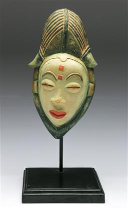 Sale 9153 - Lot 28 - A carved south East Asian hardwood mask on stand, H: 28cm