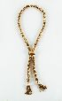 Sale 3701 - Lot 487 - A 14CT GOLD HEAVY ROPE LINK LAUREATE NECKLACE WITH TWO TASSELS AND SLIDE.