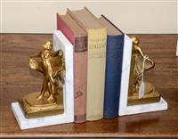 Sale 8171A - Lot 49 - French Art Deco gilt metal figures on marble book ends, H 20cm