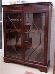 Sale 8550H - Lot 130 - A vintage Chippendale design mahogany bookcase, the shaped and dentil carved cornice above the twin quarrelled doors, the interior w...