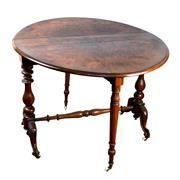 Sale 8000 - Lot 131 - A Victorian inlaid burr walnut Sutherland table on turned carved supports.