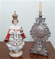 Sale 8368A - Lot 48 - A carved and painted timber Santo Nino de Cebu of the Philippines, H 47cm, together with a timber and gilt armorial candlestick