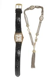 Sale 8547 - Lot 339 - VINTAGE WRISTWATCH AND ALBERT CHAIN; gold filled deco watch with chequerboard dial and 15 jewell movement signed Dorley, subsidiary...