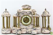 Sale 8555 - Lot 3 - 19th Century French Marble Clock Set