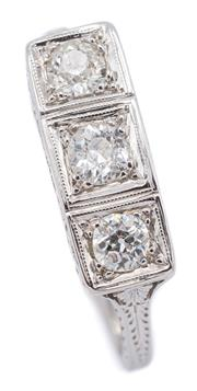 Sale 9083 - Lot 384 - A DECO STYLE THREE STONE DIAMOND RING; 16.5 x 6mm geometric top in 18ct white gold set with 3 Old European cut diamonds totalling ap...