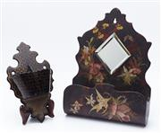 Sale 9080W - Lot 18 - Two antique wall mountable wooden pockets, one with lozenge mirror and handpainted with a floral motif, the other lacquered with a b...