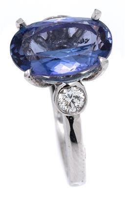 Sale 9124 - Lot 395 - AN 18CT WHITE GOLD TANZANITE AND DIAMOND RING; claw set with an approx. 3.43ct oval cut tanzanite, (12 x 8mm) some abrasions, above...