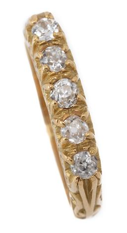 Sale 9186 - Lot 370 - A VICTORIAN STYLE 18CT GOLD DIAMOND RING; claw set across the top with 5 Old Mine cut diamonds on a carved gallery, width 4mm, size...