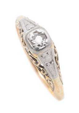 Sale 9260H - Lot 358 - A vintage 18ct gold diamond ring; set with an Old Mine cut diamond of approx. 0.10ct above pierced scrolling gallery, width 5.7mm, s...