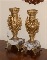 Sale 8171A - Lot 26 - A pair of Antique French gilt metal vases with cherubs on marble bases, H 35cm