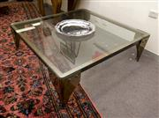 Sale 8310A - Lot 378 - An impressive glass top coffee table on a brass base, H 44 x 140cm