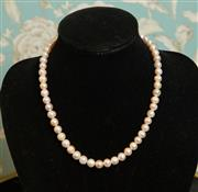 Sale 8448A - Lot 28 - Beautiful soft pink/cream single strand of fresh water pearls Condition: very good Measurements: length 49cm