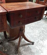 Sale 8993 - Lot 1063 - Unusual Small Regency Mahogany Centre Table, with a proper & faux drawer to each side, on turned pedestal  outswept legs with paw ca...