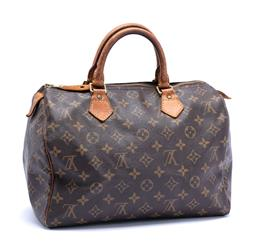 Sale 9221 - Lot 390 - A LOUIS VUITTON MONOGRAM SPEEDY 25 HANDBAG; LV monogram canvas bag with gold tone hardware (tarnish) and leather trim with twin roll...