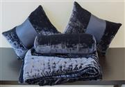 Sale 8310A - Lot 242 - A crushed deep blue velvet ensemble comprising a 195 x 220 bed cover, two rectangular cushions, and one bolster cushion, by Sheridan