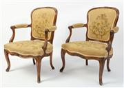 Sale 8620A - Lot 87 - A pair of distressed antique Louis XV French Provincial fruitwood bergeres. The trailing foliate carved top rail on scrolling arms a...