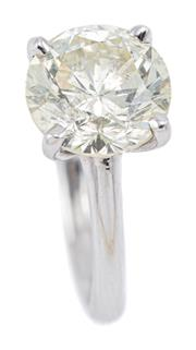 Sale 9083 - Lot 454 - A 4CT SOLITAIRE DIAMOND RING; claw set in 14ct white gold with a round brilliant cut diamond of 4ct with cert. graded as M/ P1 (extr...