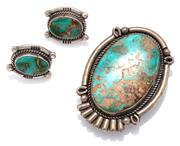 Sale 9090J - Lot 323 - A VINTAGE NATIVE AMERICAN SILVER TURQUOISE BOLO TIE AND STUD EARRINGS; bolo tie set with a 36 x 24mm turquoise to rope twist surroun...