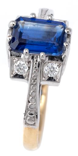 Sale 9124 - Lot 567 - AN 18CT GOLD KYANITE AND DIAMOND RING; set with an emerald cut kyanite to 4 round brilliant cut diamonds to beaded shoulders, size K...