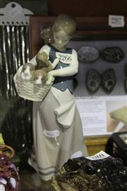 Sale 8081 - Lot 6 - Lladro Figure of a Girl with Puppies