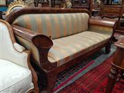 Sale 8814 - Lot 1064 - Biedemeier Style Mahogany Settee, upholstered in gold & green striped fabric, having carved fascia & outswept feet (fault to fabric)