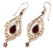 Sale 9083 - Lot 358 - A PAIR OF EDWARDIAN STYLE GARNET PEARL EARRINGS; seed pearl set pendulous drops each millegrain set with an articulating pear cut ga...