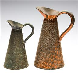 Sale 9253 - Lot 8 - A crocodile skin effect copper jug (H:34cm) together with a smaller example (H:26cm)