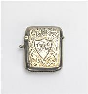 Sale 8196F - Lot 357 - A HALLMARKED STERLING SILVER VESTA CASE; finely engraved case with monogrammed cartouche, 40 x 30mm, Birmingham 1912.