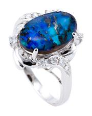 Sale 8899 - Lot 375 - AN OPAL AND DIAMOND DRESS RING; featuring an approx. 3.2ct oval boulder opal with blue/green flash to surround and shoulders set wit...