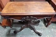 Sale 8993 - Lot 1087 - Victorian Burr Walnut Card Table, with profusely carved apron, on a pedestal with carved outswept legs (slight faults to top, H:70 W...