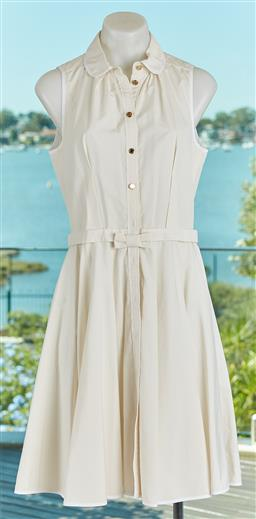 Sale 9120K - Lot 38 - A Louis Vuitton off white sleeveless tunic dress; with bow front waist and golden buttons, size 38  minor stain and attention need...