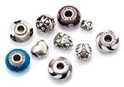 Sale 9149 - Lot 527 - TEN PANDORA SILVER AND GLASS CHARMS; 5 coloured art glass 15mm round charms and 5 assorted designs including porcupine, heart, butte...