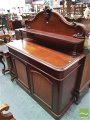 Sale 8416 - Lot 1084 - Victorian Mahogany Chiffonier, the carved back with supported shelf, a long drawer & two arched panel doors