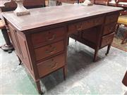 Sale 8917 - Lot 1072 - Late Victorian Mahogany Desk, with brown tooled leather top, seven drawers & on tapering square legs