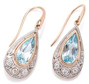 Sale 9083 - Lot 418 - A PAIR OF 9CT ROSE GOLD TOPAZ AND DIAMOND DROP EARRINGS; each millegrain set with an approx. 2.25ct blue pear cut topaz above 3 roun...