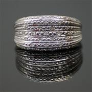Sale 8196F - Lot 329 - A STERLING SILVER DIAMOND RING; ring size M
