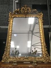 Sale 8882 - Lot 1089 - Elaborate Gilt Gesso Mirror, with pierced scroll to the centre and articulated corners, with suspended putti playing flute & palm le...