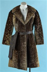Sale 9090F - Lot 87 - A CORNELIUS STUDIO DESIGN THREE QUARTER COAT; Seal skin with leather trim and belt, size 10