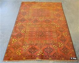Sale 9196 - Lot 1025 - Afghan Baluchi Wool Carpet, with two square panels flanked by alternating diamonds (230 x 158cm)