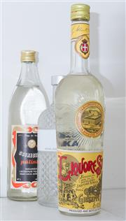 Sale 8486A - Lot 72 - Three bottles of clear spirits including; Absolut Vodka, Hungarian Liko Ripari Palinka fruit brandy and Liqueur Strega