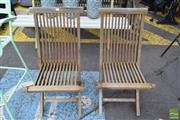 Sale 8532 - Lot 1216 - Pair Of Teak Outdoor Folding Chairs