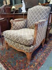 Sale 8576 - Lot 1081 - French Style Carved Beech Armchair, upholstered in a diaper patterned fabric with Royal insignia