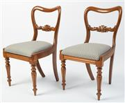 Sale 8620A - Lot 88 - A pair of English antique mahogany side chairs c. 1875. The kidney shaped and carved bar backs above blue chain link upholstered rem...