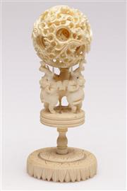 Sale 9064 - Lot 70 - A Carved Ivory Puzzle Ball Decorated with Elephant Base (H17.5cm)