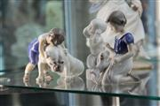 Sale 8269 - Lot 9 - Royal Copenhagen Figurine of Boy With Dog With Others Incl Girl With Puppy(3)