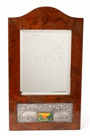 Sale 9048A - Lot 3 - A Liberty & Co walnut veneered arch top mirror with art nouveau embossed and pricked pewter design enclosing an enamel plaque depict...